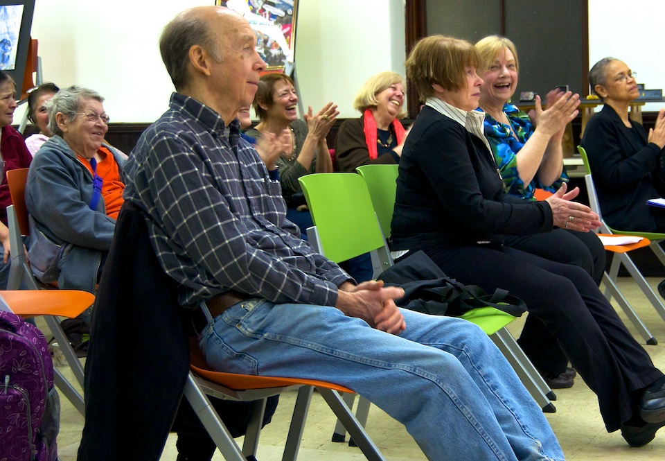 Audience members enjoy a performance during the culminating event of a creativea aging workshop series.