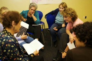 Participants doing group work in a writing workshop.