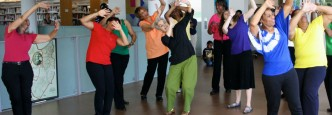Photo of women dancing during a creative aging workshop at Grove Hall Library, part of the BPL
