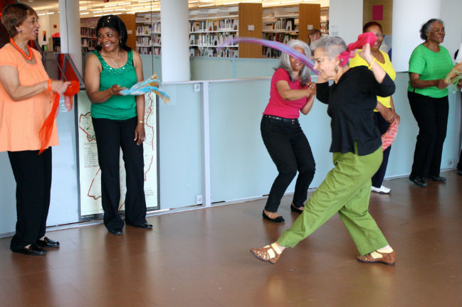 "Joan Green dances with her ""Dancing on the Balcony"" students at the Grove Hall branch of the Boston Public Library, spring 2013."